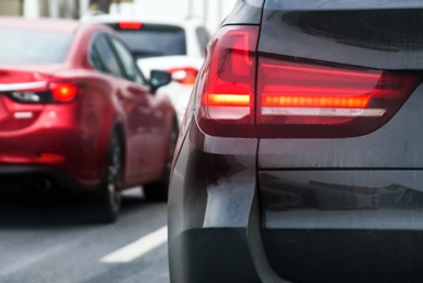 backs of cars in traffic