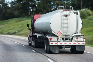 tanker truck driving down the road