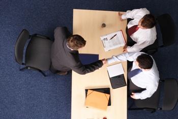three men involved in mediation