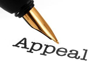 Pen Writing Appeal on Paperwork Izquierdo Law Firm