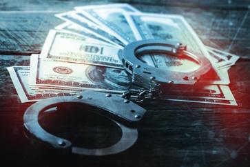 Money Laundering Money and Handcuffs Federal Crimes Defense Lawyer Izquierdo Law