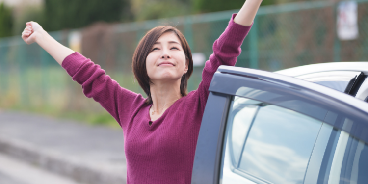 Woman stretching next to car