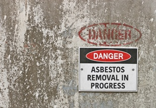 Asbestos Removal Sign on an Alabama Building Neblett, Beard & Arsenault