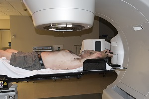 Patient receives radiation therapy treatment for his cancer