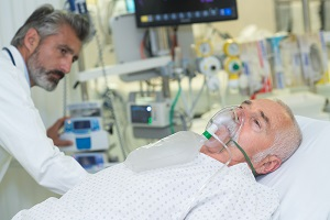 An older mesothelioma patient receives supplementary oxygen
