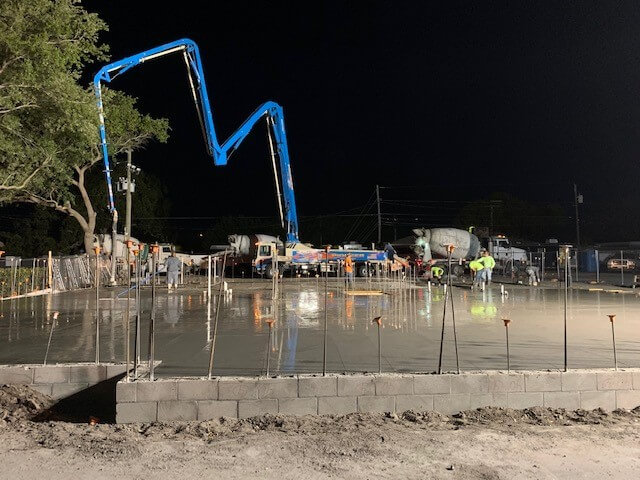 Concrete foundation being poured for the new building