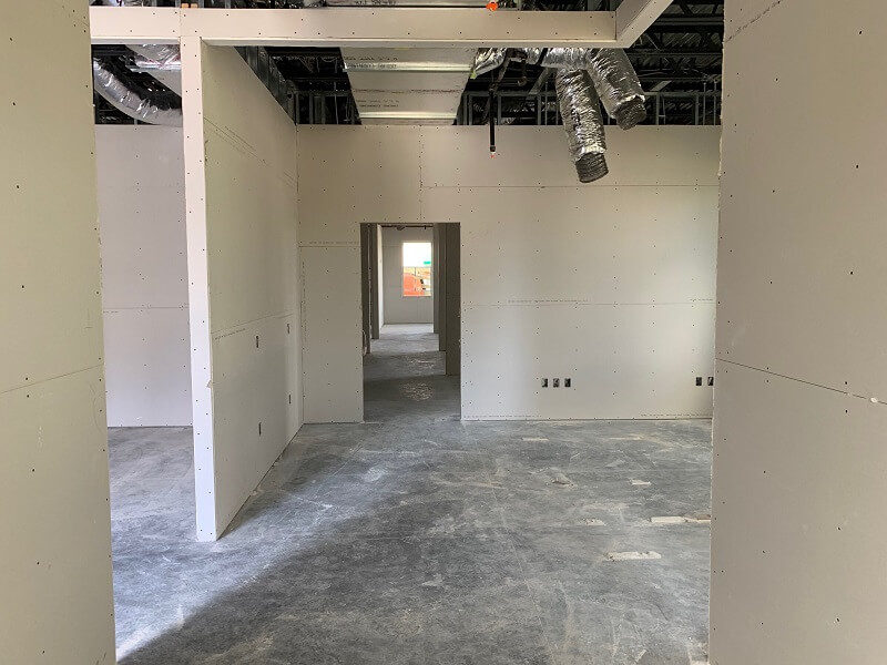 Drywall on first level of new building