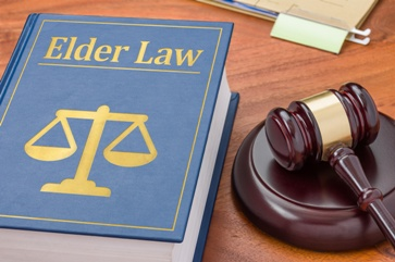 Elder Law Book With the Scales of Justice and a Gavel