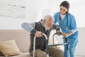 Elderly Man Getting Assistance With a Walker
