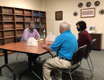 Florida guardianship attorney Kevin Wimmer meeting with clients