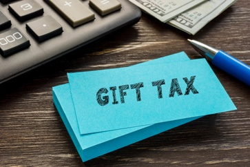 Gift Tax Sticky Note and a Pen