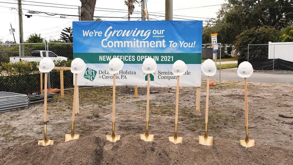 Gold shovels used in groundbreaking ceremony for DeLoach, Hofstra & Cavonis' new law office building in Seminole