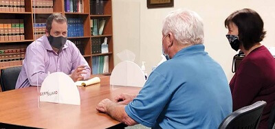 Guardianship attorney Kevin Wimmer meeting with clients