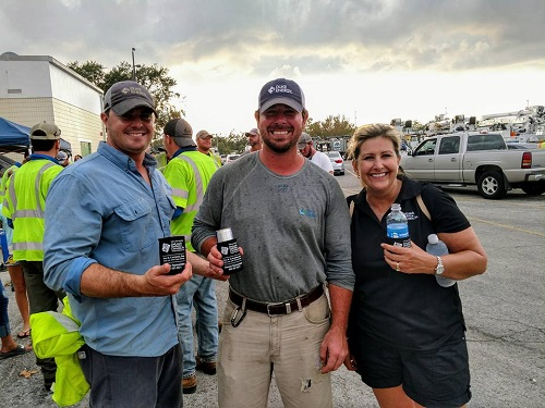 2017 Koozie Contest Winner: Probate Assistant April Ellison with linemen during Hurricane Irma