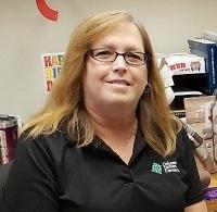 Lorry Feldmeyer at her desk