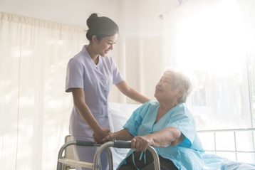 Elderly Mother With a Nurse in a Nursing Home