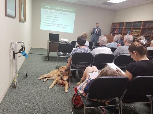 Rep speaking at an estate planning seminar
