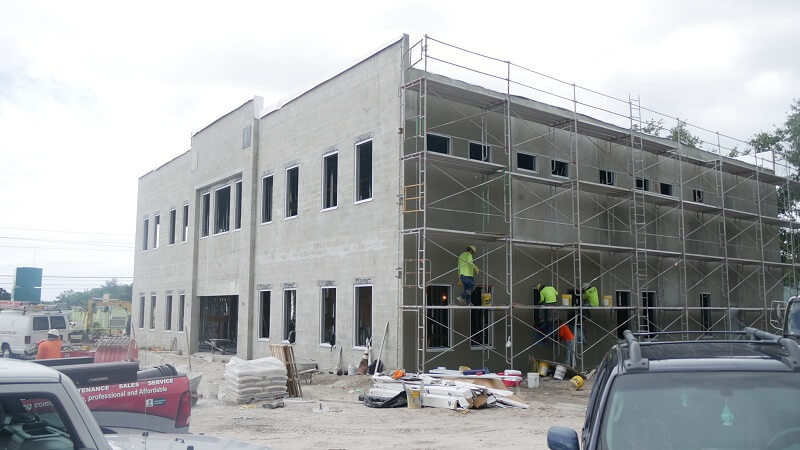 Stucco being added to the new building exterior