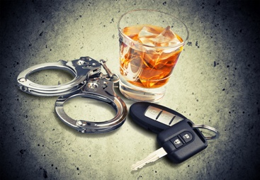Handcuffs, Car Keys, and a Glass of Alcohol