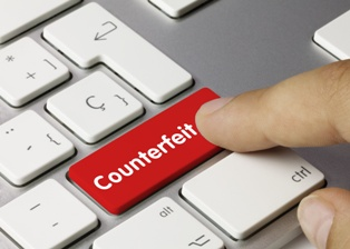 Counterfeit Charges Button on a Computer