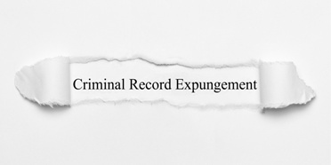 Criminal Record Expungement Torn Paperwork