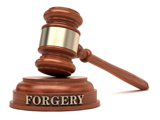Gavel Engraved With Forgery Text