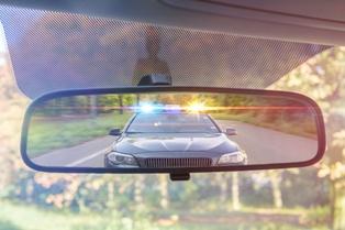 Police Car Lights in a Car Mirror