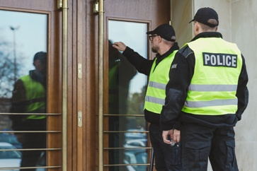 Police Officers Knocking on a Door