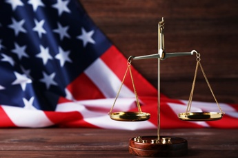 Scales of Justice With an American Flag in the Background