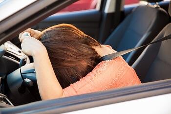 Upset woman driver gets negative DMV points for traffic violation