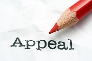 Appeal Paperwork With a Red Pencil