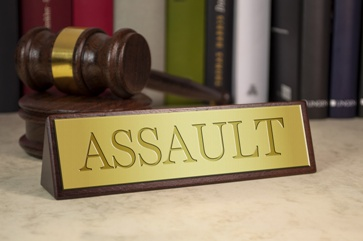 Assault Tag on a Lawyer's Desk With a Gavel
