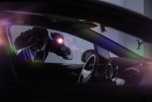 Car Thief Breaking Into a Car in North Carolina