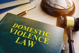 Domestic Violence Law Book With a Wooden Gavel