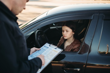 Driver Receiving a Traffic Ticket From an Officer