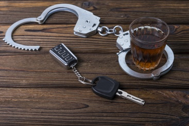 Handcuffs, Car Keys, and an Alcoholic Drink