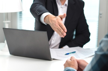 Lawyer Shaking the Hand of a Potential Client