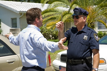Officer Giving a Drunk Driver a HGN Test