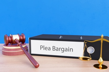Plea Bargain Folder With Scales of Justice and Gavel