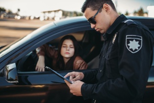 Police Officer Giving a Ticket to a North Carolina Driver