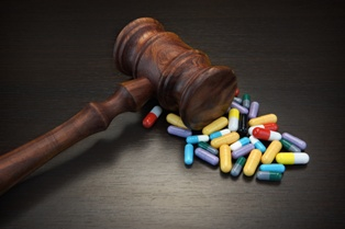 Prescription Drug Medications With a Wooden Gavel