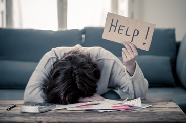 Stressed Woman Holding a Help Sign