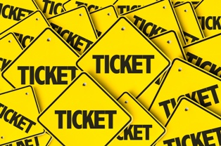 Yellow Ticket Signs in a Pile