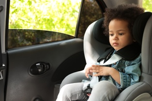 Young Child in the Back Seat of a Car After the Driver Has Been Arrested for DWI