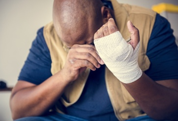 Distraught Worker With an Injured Hand