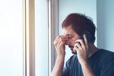 Distraught Man on the Phone With a Third-Party Administrator