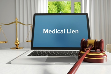 Medical Lien on a Computer Screen With a Gavel and Scales of Justice