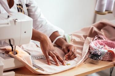 Seamstress sewing a dress