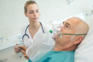 man-receiving-oxygen-for-a-respiratory-disorder