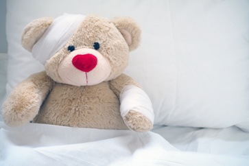 Injured Childrens Teddy Bear With Bandages